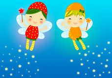 Cute firefly fairies. Two cute firefly fairies with their magic wands flaying on a blue background leaving a stray of magic shiny stars Royalty Free Stock Photography
