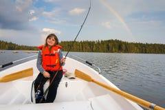 Cute fishing girl in beautiful scenery Royalty Free Stock Photo