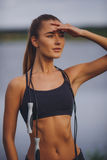 Cute fit woman with skipping rope Royalty Free Stock Photography