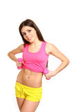 Cute fitness girl with dumbbells showing her belly on white back Royalty Free Stock Images