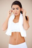 Cute fitness girl with headphones Stock Photography