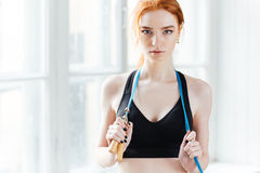Cute fitness girl holding skipping rope Royalty Free Stock Image