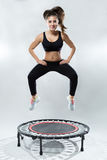 Cute fitness-girl play with rebounder Royalty Free Stock Photography