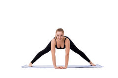 Cute fitness girl stretching before doing exercise Stock Photo