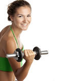 Cute fitness girl working out with dumbbell Stock Photography