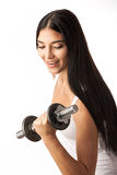 Cute fitness girl working out with dumbbells Royalty Free Stock Photo