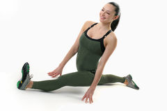 Cute fitness model holding the splits. Image of a fit female doing the splits Stock Photos