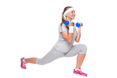 Cute fitness woman doing exercises Royalty Free Stock Photo