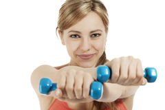 Cute fitness woman holding dumbbells Stock Photo