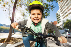 Cute five years old boy riding his bike in town Royalty Free Stock Photography