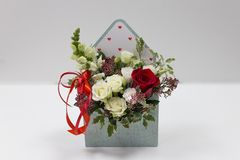 Free Cute Floral Arrangement Gift Of Fresh Flowers In A Box In The Form Of An Envelope On A Light Background. Stock Image - 158878811