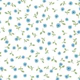 Cute floral seamless pattern. Repeated small blue flowers and green leaves on white background. Stock Photos