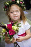 Cute Flower Girl. A flower girl at a wedding reception royalty free stock photo