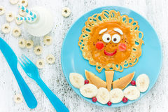 Cute flower pancakes with banana for kids breakfast. Good morning concept royalty free stock photo