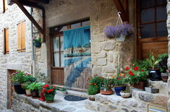 Cute flowering doors and windows, Ardeche, France Stock Photos