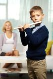 Cute flutist Stock Image