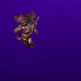 Cute flying angel with lyute  on purple background Royalty Free Stock Photos