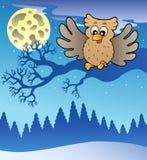 Cute flying owl in snowy landscape Stock Photo