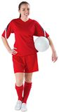 Cute football player holding ball Royalty Free Stock Images