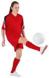 Cute football player kicking ball Royalty Free Stock Image