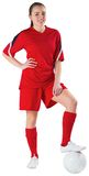 Cute football player standing with ball Royalty Free Stock Photo