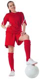 Cute football player standing with ball Royalty Free Stock Image