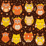 Cute forest owls vector seamless pattern. Hand drawn lovely birds background in colors of brown, orange and yellow Stock Image