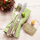 Cute fork and knife with Happy Easter tag Stock Images