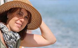 Cute forty year old woman with straw hat on the cruise ship Royalty Free Stock Photos