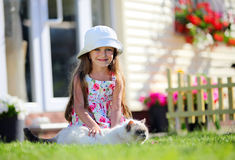 Cute four-year girl stroking her cat Stock Images