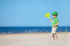 Cute four years old boy playing on tropical beach Stock Images