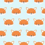 Cute foxes seamless vector pattern. Orange fox s head on blue background royalty free illustration