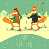 Cute foxes skiing on the piste Stock Photos