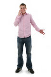 Cute Freckled Male Teen on Phone. Cute freckled male teen talking on phone. Shot with Canon 20D Royalty Free Stock Photo