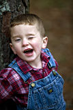 Cute freckled redheaded boy winking Royalty Free Stock Photo