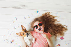 Cute friend lying on a wooden floor. Stock Images