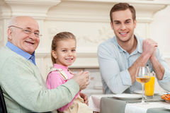 Cute friendly family is dining together Stock Photography