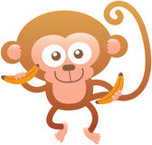 Cute friendly monkey smiling and holding bananas Royalty Free Stock Images