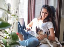 Cute friendly young woman relaxing at home royalty free stock photo