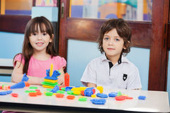 Cute Friends With Construction Blocks In Stock Images