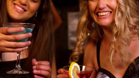 Cute friends having cocktails at a party stock footage