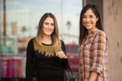 Cute friends meeting at a shopping center Royalty Free Stock Photo