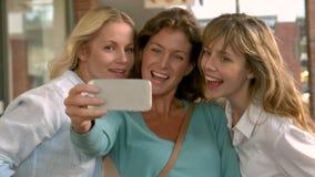 Cute friends taking a selfie stock video footage