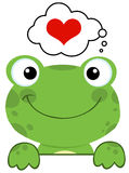 Cute frog over a sign board. And speech bubble with heart Stock Images