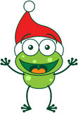 Cute frog wearing Santa hat and celebrating Christmas Royalty Free Stock Images