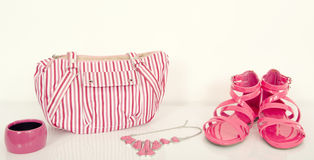 Cute fucsia sandals with matching bag and jewellery. Royalty Free Stock Image