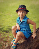 Cute fun kid girl in hat and fashion blue dress Stock Photography