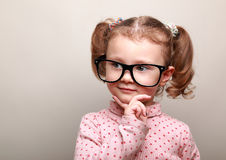 Cute fun kid girl thinking about Royalty Free Stock Photography