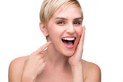 Cute fun laughing female with perfect white teeth straight smile pointing at mouth Stock Image
