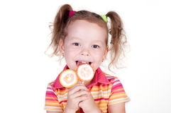 Cute fun little girl holding lolly pop Stock Photos